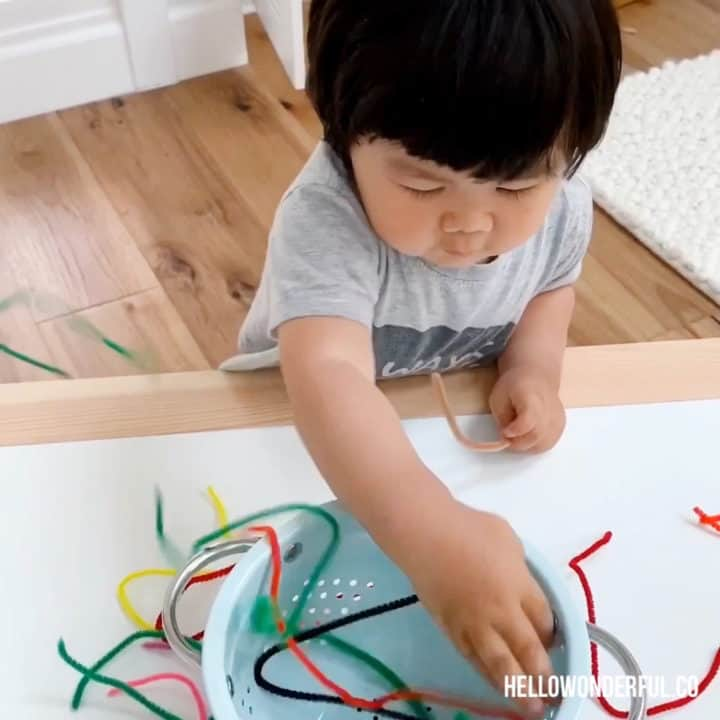 easy toddler activity: colander and pipe cleaners