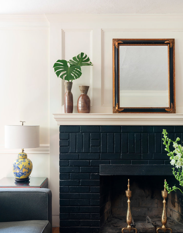 painted brick fireplace in black
