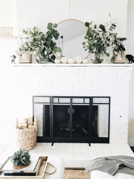 fall decor around fireplace