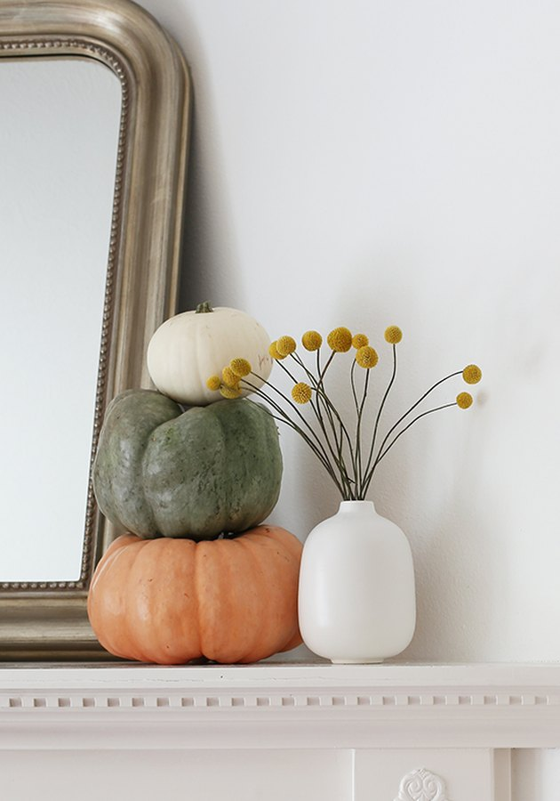 fall mantel with small squashes