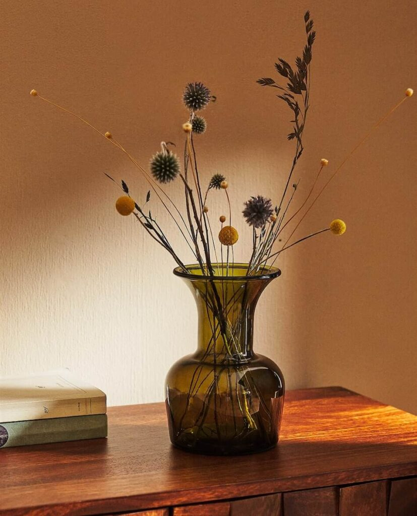 dried fall flowers in glass vase