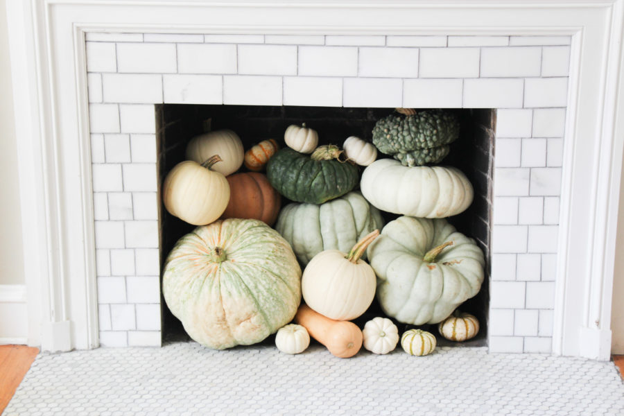 pumpkins stacked in fireplace